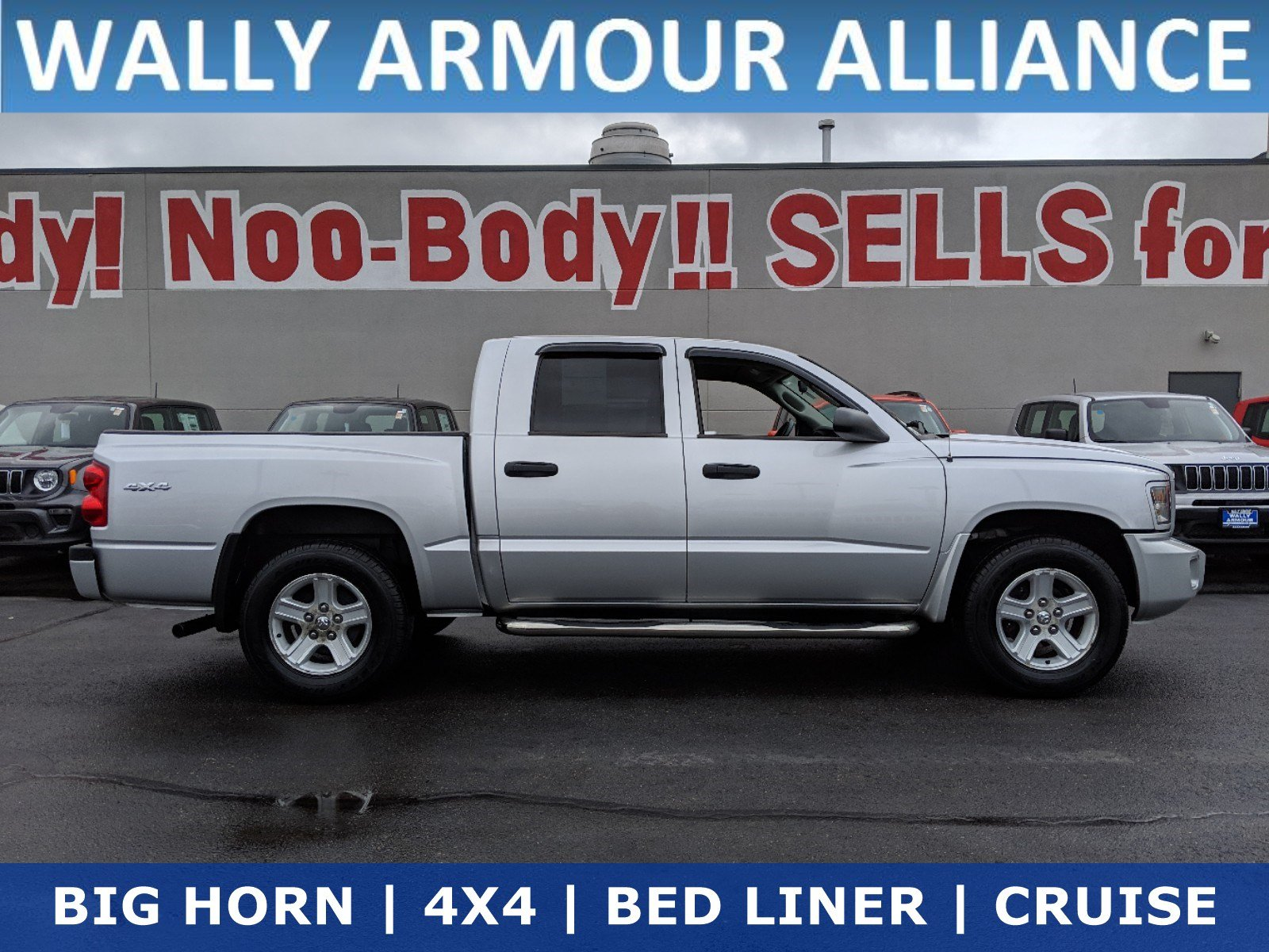 Pre-Owned 2011 Dodge Dakota Bighorn/Lonestar